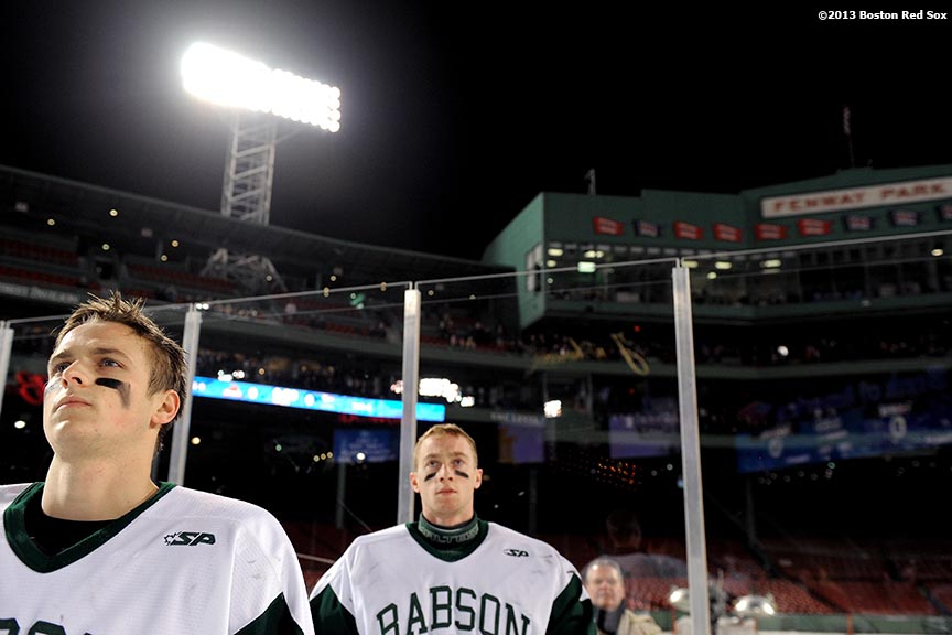 """Starting lineups are introduced before a game between Babson College and Norwich University at Frozen Fenway Thursday, January 9, 2014 at Fenway Park in Boston, Massachusetts."""