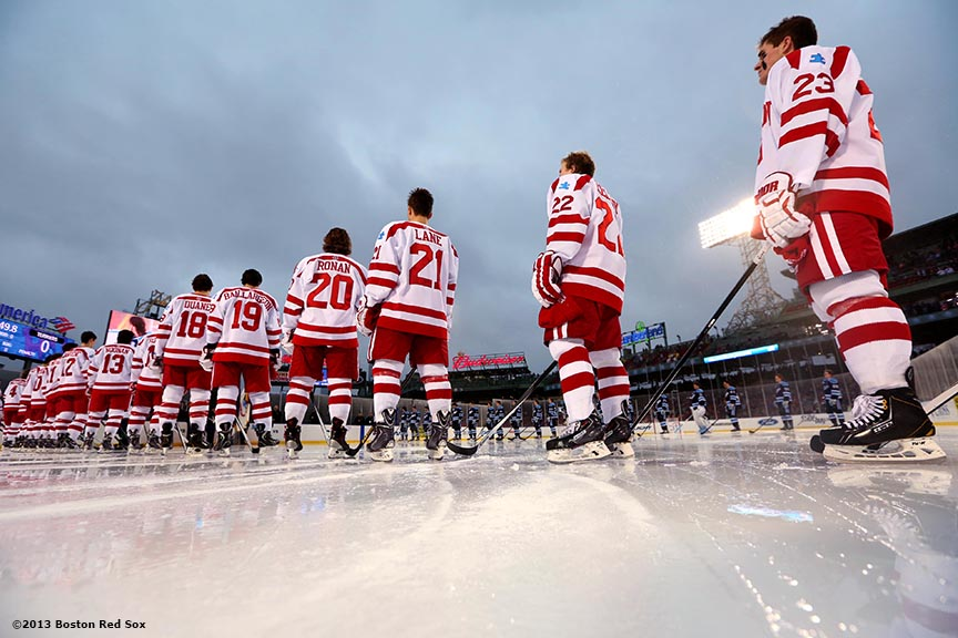 """Starting lineups are introduced before a game between University of Maine and Boston University at Frozen Fenway Saturday, January 11, 2014 at Fenway Park in Boston, Massachusetts."""