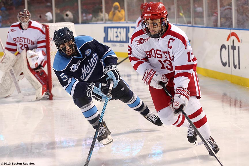 """Game action during a game between University of Maine and Boston University at Frozen Fenway Saturday, January 11, 2014 at Fenway Park in Boston, Massachusetts."""