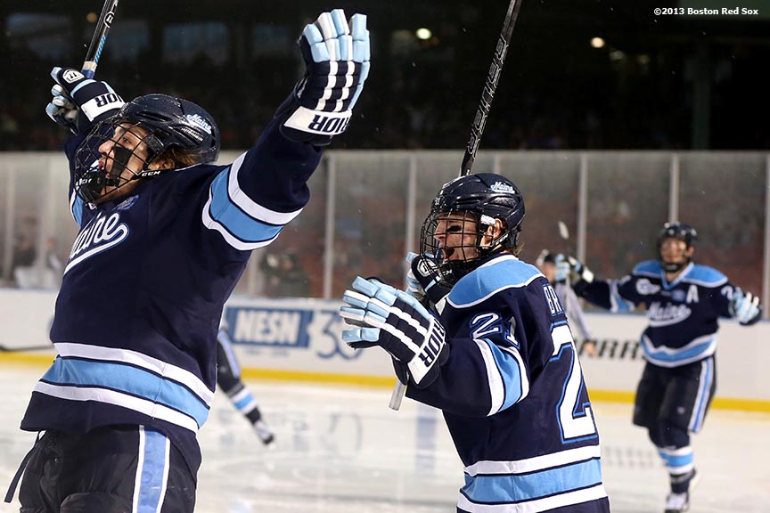 """University of Maine players celebrate after scoring a goal against Boston University Saturday, January 11, 2014 at Fenway Park in Boston, Massachusetts."""