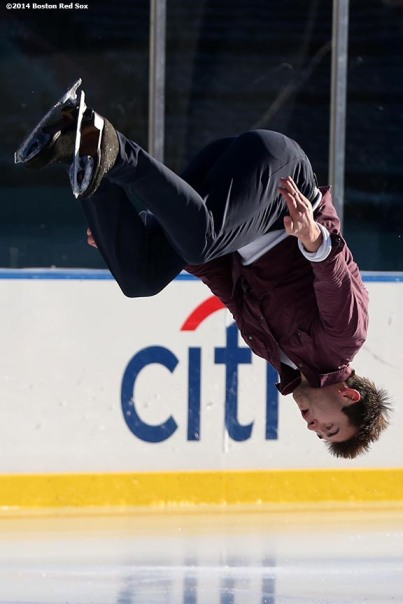 """2011 US Men's Champion Ryan Bradley does a backflip while performing during a figure skating showcase at Fenway Park as part of Frozen Fenway Monday, January 13, 2014 in Boston, Massachusetts."""