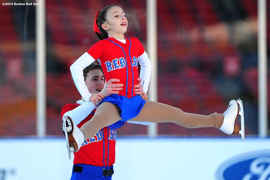 """Jade Esposito and Nathan Rensing, 2014 Juvenile Pairs National Competitors, perform during a figure skating showcase at Fenway Park as part of Frozen Fenway Monday, January 13, 2014 in Boston, Massachusetts."""
