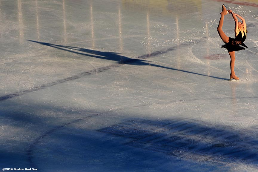 """Junior Ladies skater Heidi Munger performs during a figure skating showcase at Fenway Park as part of Frozen Fenway Monday, January 13, 2014 in Boston, Massachusetts."""