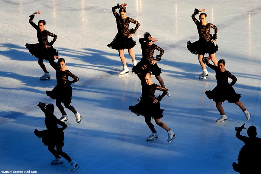 """The Lexettes Junior Synchronized Skating Team perform during a figure skating showcase at Fenway Park as part of Frozen Fenway Monday, January 13, 2014 in Boston, Massachusetts."""