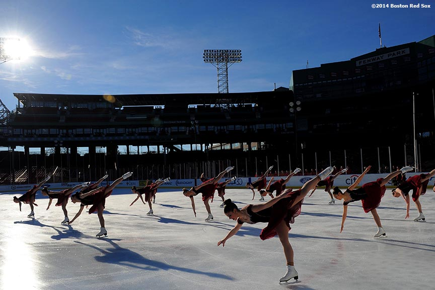 """The Haydenettes Senior Synchronized Skating Team performs during a figure skating showcase at Fenway Park as part of Frozen Fenway Monday, January 13, 2014 in Boston, Massachusetts."""
