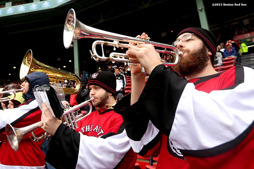 """The Northeastern University marching band plays during a game against University of Massachusetts Lowell at Frozen Fenway Saturday, January 11, 2014 at Fenway Park in Boston, Massachusetts."""