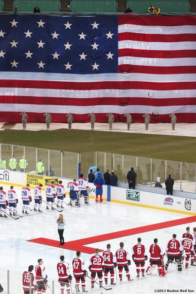 """The starting lineups are introduced before a game between University of Massachusetts Lowell and Northeastern University at Frozen Fenway Saturday, January 11, 2014 at Fenway Park in Boston, Massachusetts."""