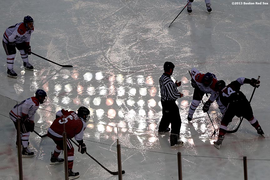 """Game action during a game between University of Massachusetts Lowell and Northeastern University at Frozen Fenway Saturday, January 11, 2014 at Fenway Park in Boston, Massachusetts."""
