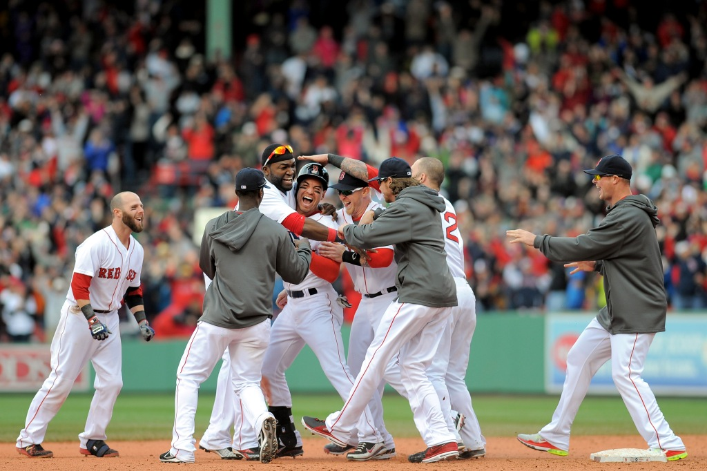 """Members of the Boston Red Sox mob center fielder Jacoby Ellsbury after hitting a walk-off single in the bottom of the ninth inning to defeat the Cleveland Indians 6-5 at Fenway Park in Boston, Massachusetts Sunday, May 26, 2013. The Red Sox came back from a 5-1 deficit in the eighth inning."""