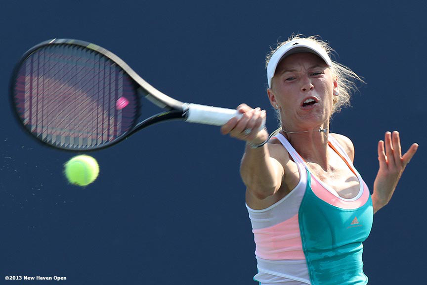 """Caroline Wozniacki connects on a forehand on Day 6 of the New Haven Open at Yale University in New Haven, Connecticut Wednesday, August 21, 2013."""