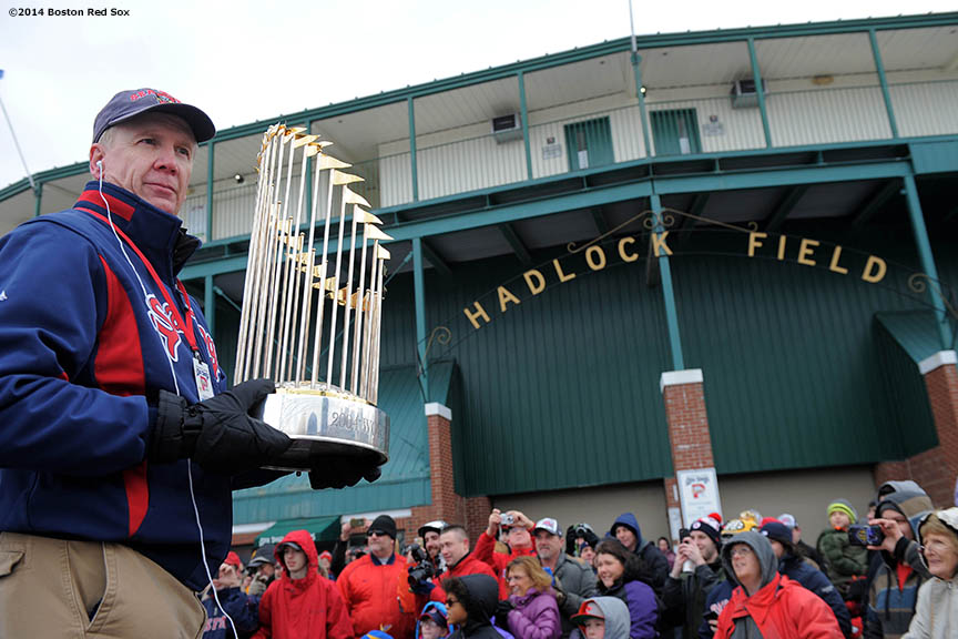 """A Portland Sea Dogs security guard displays the World Series trophy during an appearance at Hadlock Field, home of the Portland Sea Dogs, as part of a World Series trophy tour throughout Maine Saturday, January 25, 2014 in Portland, Maine."""