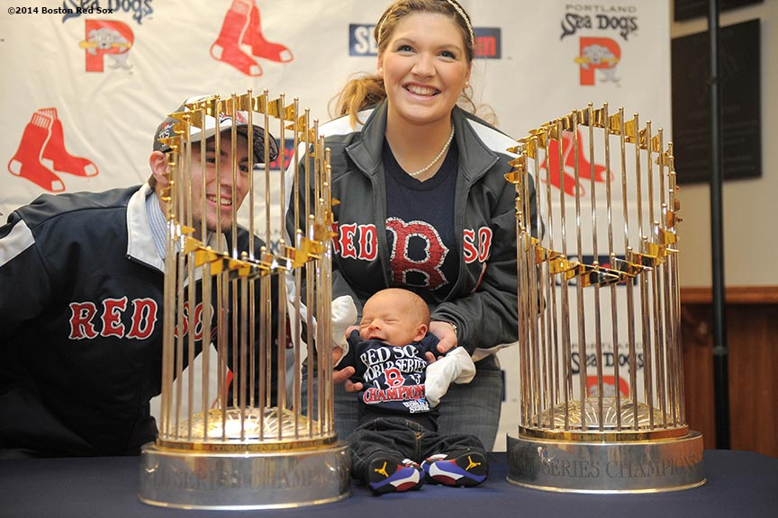 """Fans pose with the 2004, 2007, and 2013 Boston Red Sox World Series trophies during an appearance at Hadlock Field, home of the Portland Sea Dogs, as part of a World Series trophy tour throughout Maine Saturday, January 25, 2014 in Portland, Maine."""