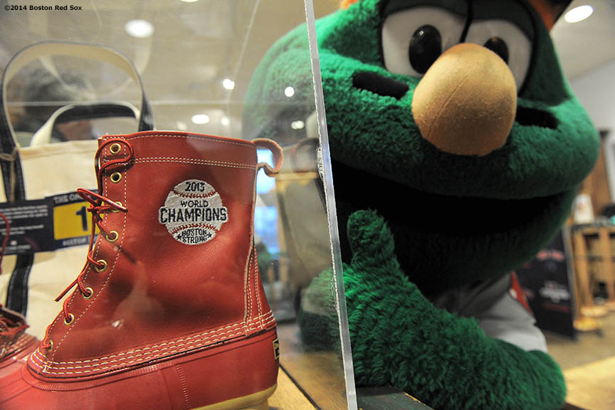 """Wally the Green Monster poses with the limited edition 2013 Boston Red Sox World Championship Bean Boots during an appearance at the L.L. Bean headquarters in Freeport, Maine Saturday, February 25, 2014 as part of a World Series trophy tour throughout Maine."""