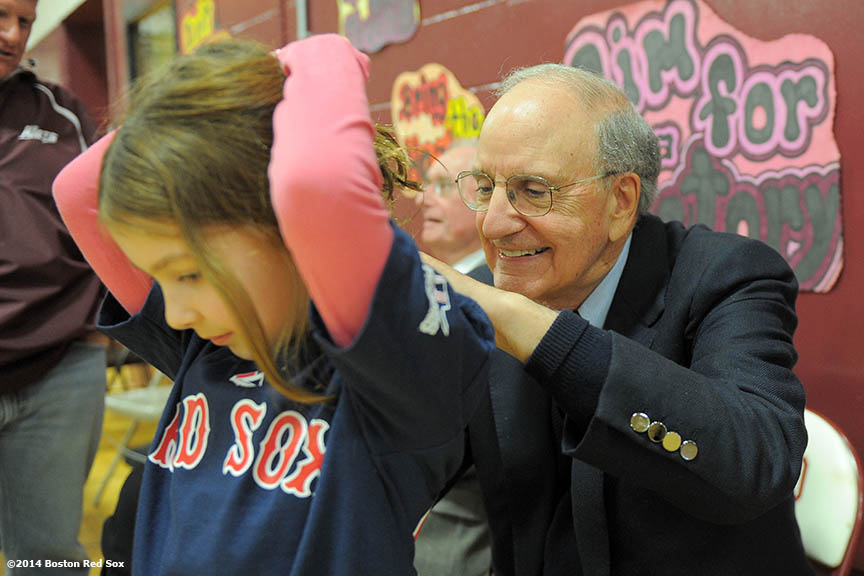 """Former Senator of Maine George Mitchell signs an autograph during an appearance at Orano High School in Orono, Maine Sunday, February 26, 2014 as part of a World Series trophy tour throughout Maine."""