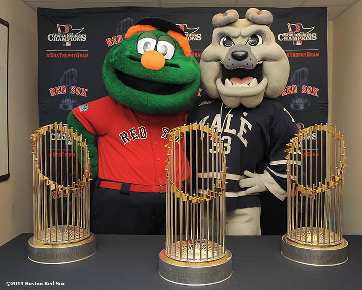 Boston Red Sox mascot Wally the Green Monster and Yale University Mascot Boola the Bulldog pose with the 2004, 2007, and 2013 World Series trophies during an appearance at the Yale Child Study Center at Yale University in New Haven, Connecticut Monday, February 27, 2014  as part of a World Series trophy tour through Connecticut.""