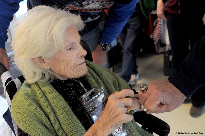 """A 101 year old veteran observes the 2004 Boston Red Sox World Series championship ring during an appearance at the VA Hospital in Bedford, Massachusetts Wednesday, February 12, 2014 as part of the World Series trophy tour throughout Massachusetts."""