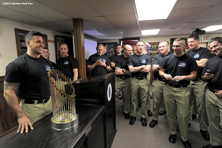 """Police officers in training pose with the 2013 Boston Red Sox World Series trophy during an appearance at the Reading Police Academy in Reading, Massachusetts Wednesday, February 12, 2014 as part of the World Series trophy tour throughout Massachusetts."""
