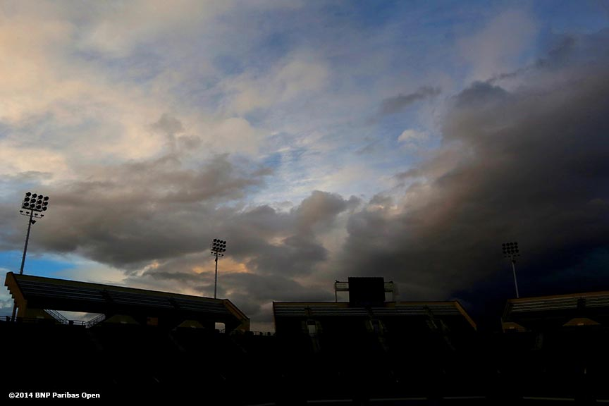"""Storm clouds form over Stadium 1 at the Indian Wells Tennis Garden before the start of the 2014 BNP Paribas Open in Palm Springs, California Friday, February 28, 2014."""