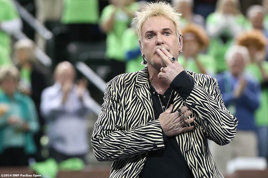 """""""Jimmy Hopper sings the National Anthem during the opening ceremonies for the newly constructed Stadium 2 at the Indian Wells Tennis Garden before the McEnroe Challenge for Charity presented by Esurance Saturday,  March 1, 2014 in Indian Wells, California."""""""
