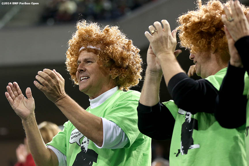 """Fans cheer during the McEnroe Challenge for Charity presented by Esurance Saturday,  March 1, 2014 in Indian Wells, California."""