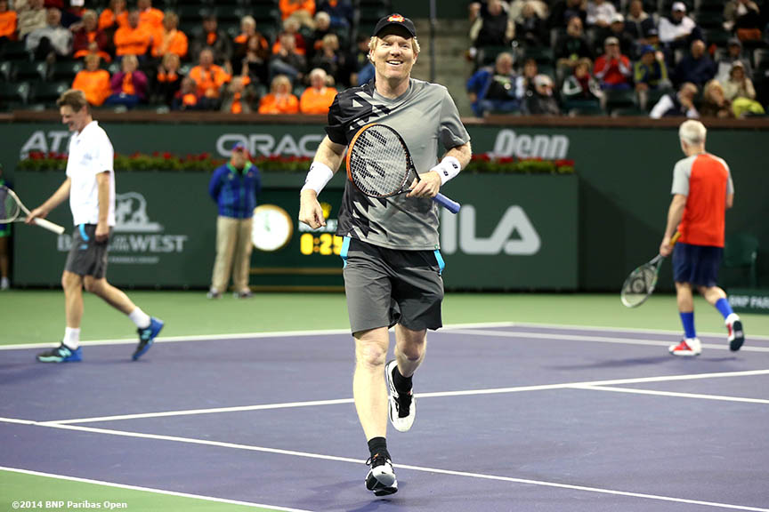 """Jim Courier reacts after winning a point during the McEnroe Challenge for Charity presented by Esurance Saturday,  March 1, 2014 in Indian Wells, California."""