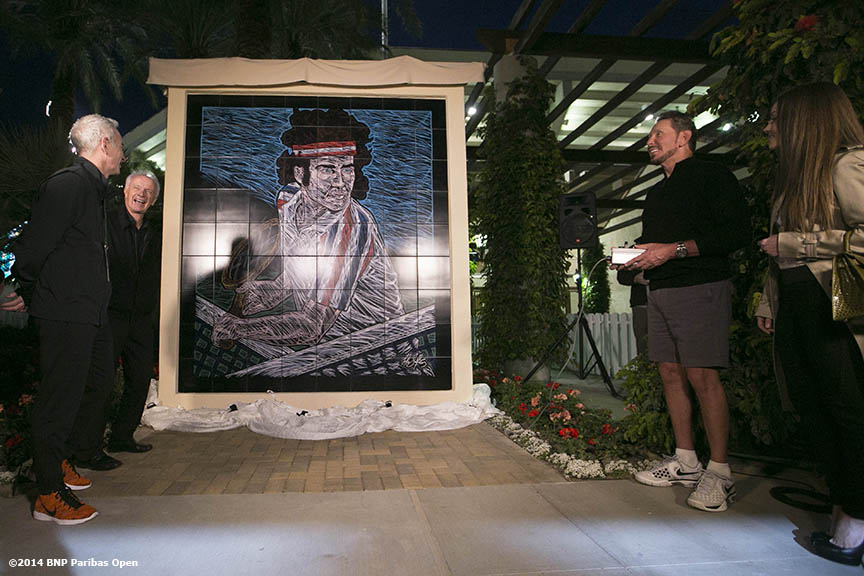 """A mural of John McEnroe is unveiled at the Indian Wells Tennis Garden before the McEnroe Challenge for Charity presented by Esurance Saturday,  March 1, 2014 in Indian Wells, California."""