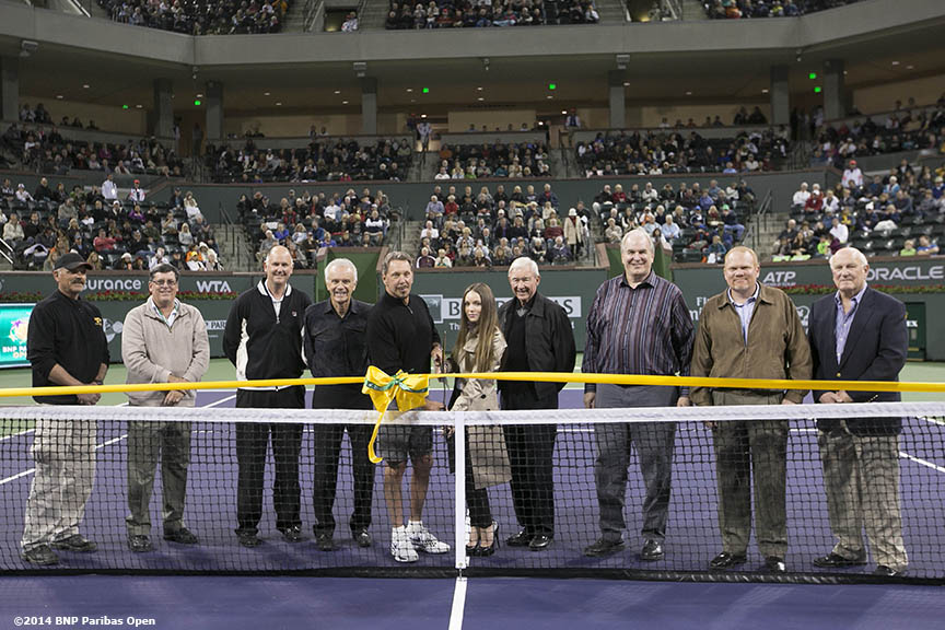 """Dignitaries take part in a ribbon cutting ceremony for the newly constructed Stadium 2 at the Indian Wells Tennis Garden before the McEnroe Challenge for Charity presented by Esurance Saturday,  March 1, 2014 in Indian Wells, California."""