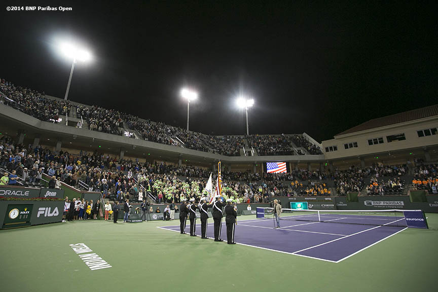 """The National Anthem is sung during the opening ceremonies for the newly constructed Stadium 2 at the Indian Wells Tennis Garden before the McEnroe Challenge for Charity presented by Esurance Saturday,  March 1, 2014 in Indian Wells, California."""