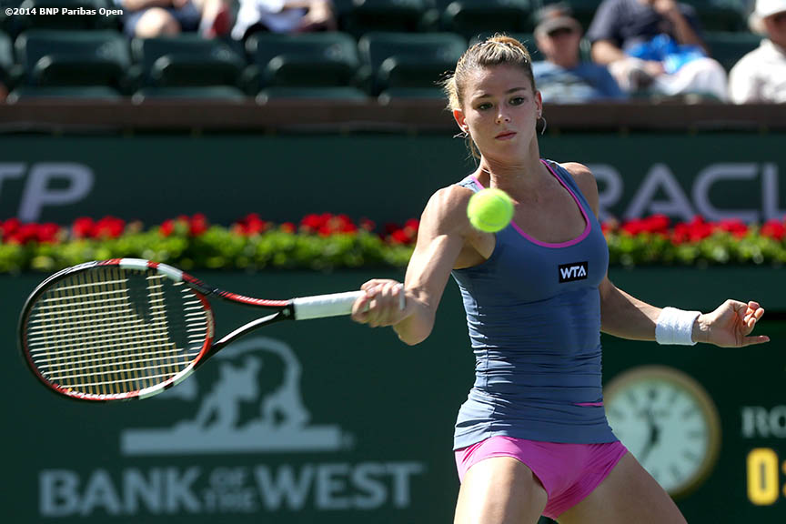 """Camila Giorgi hits a forehand during a qualifying much against Irina Falconi at the Indian Wells Tennis Garden in Indian Wells, California Monday, March 3, 2014."""