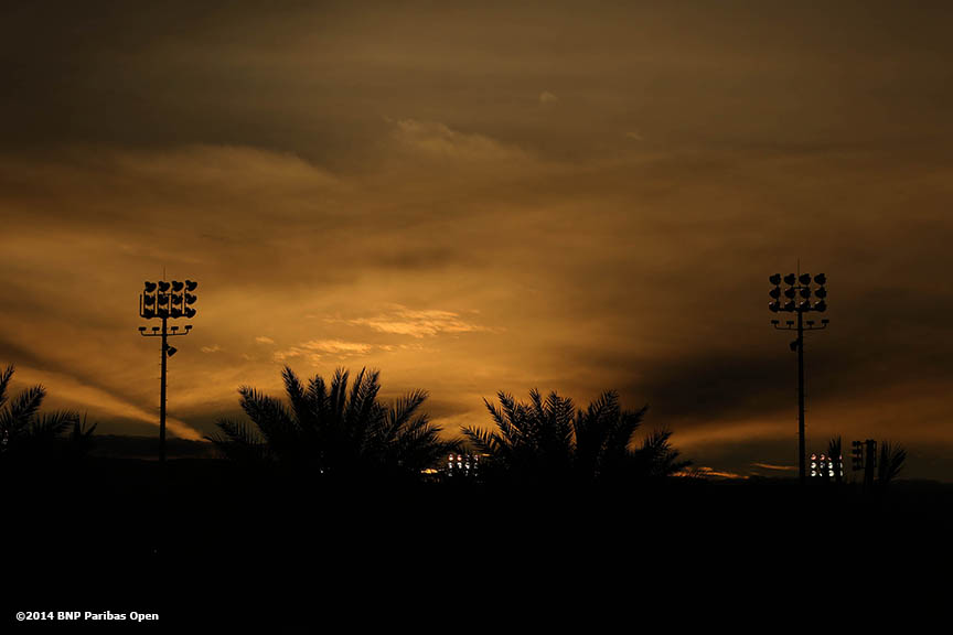 """The sun sets over the grounds of the Indian Wells Tennis Garden in Indian Wells, California Monday, March 3, 2014."""