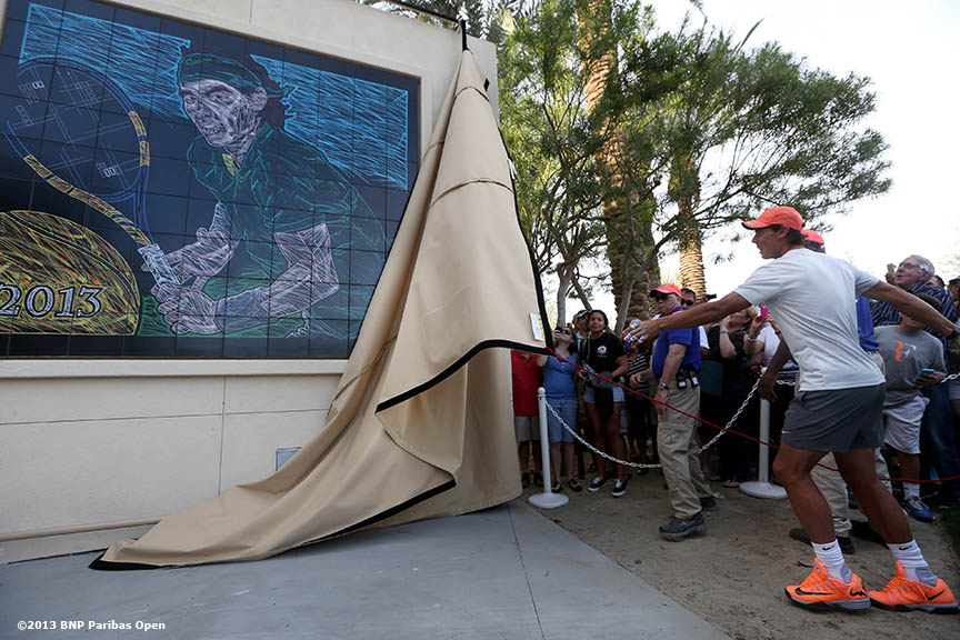 """Rafael Nadal unveils a mural of himself outside of Stadium 1 at the Indian Wells Tennis Garden in Indian Wells, California Tuesday, March 4, 2014."""