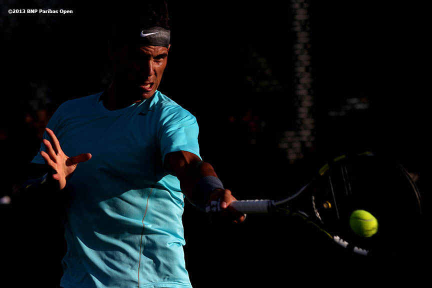 """Rafael Nadal hits a forehand on the practice courts at the Indian Wells Tennis Garden in Indian Wells, California Tuesday, March 4, 2014."""