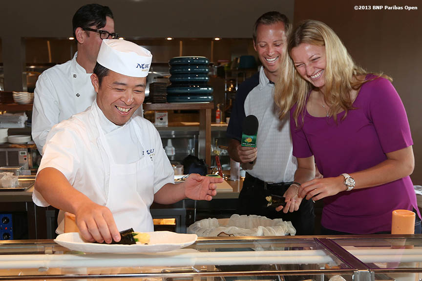 """Petra Kvitova gets a Sushi rolling lesson from Gregorio Stephenson, head chef at Nobu in the newly constructed Stadium 2 at the Indian Wells Tennis Garden in Indian Wells, California Tuesday, March 4, 2014."""