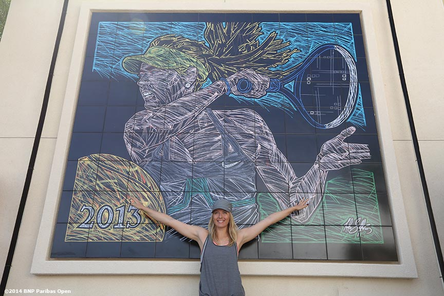 """Maria Sharapova poses for a photograph during the unveiling of a mural of herself at the Indian Wells Tennis Garden in Indian Wells, California Thursday, March 7, 2014."""