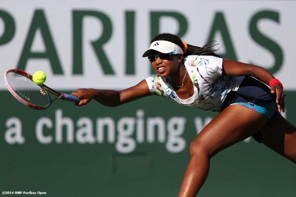 """Victoria Duval hits a forehand during her qualifying round match against Alisa Kleybanova at the BNP Paribas Open in Indian Wells, California Thursday, March 7, 2014."""