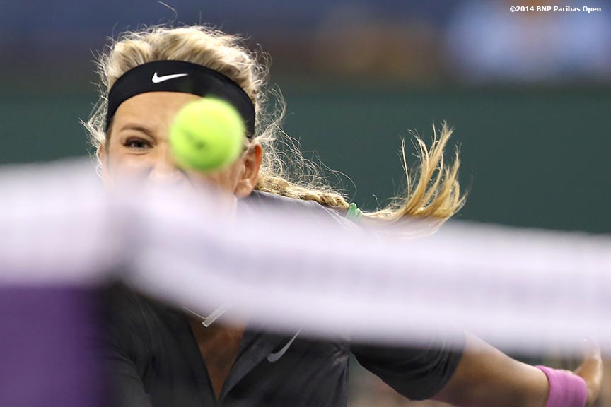 """Victoria Azarenka hits a volley during a match against Lauren Davis in Stadium 1 at the BNP Paribas Open in Indian Wells, California Friday, March 7, 2014."""