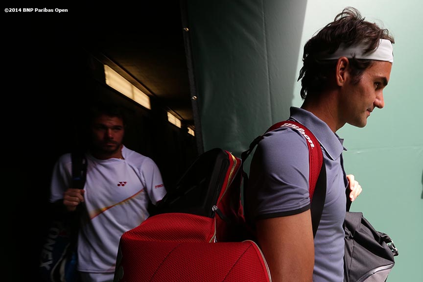 """Roger Federer and Stan Wawrinka walk out of the tunnel before playing a first round doubles match against Rohan Bopanna and Aisam-Ul-Haq Qureshi at the 2014 BNP Paribas Open in Indian Wells, California Friday, March 7, 2014."""