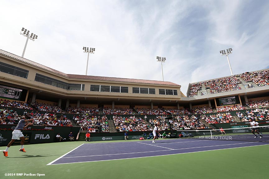 """Roger Federer and Stan Wawrinka play a first round doubles match against Rohan Bopanna and Aisam-Ul-Haq Qureshi at the 2014 BNP Paribas Open in Indian Wells, California Friday, March 7, 2014."""
