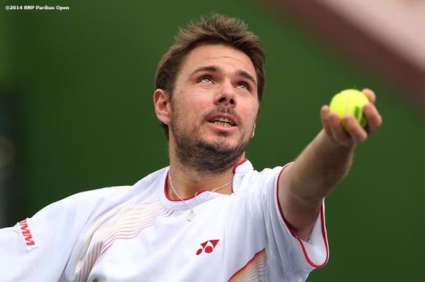 """Stan Wawrinka serves during a first round doubles match against Rohan Bopanna and Aisam-Ul-Haq Qureshi at the 2014 BNP Paribas Open in Indian Wells, California Friday, March 7, 2014."""