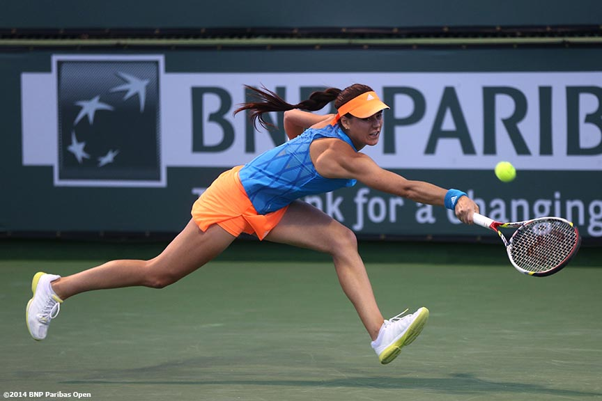 """Sorana Cirstea lunges for a backhand from Camila Giorgi at the BNP Paribas Open Saturday, March 8, 2014 in Indian Wells, California."""