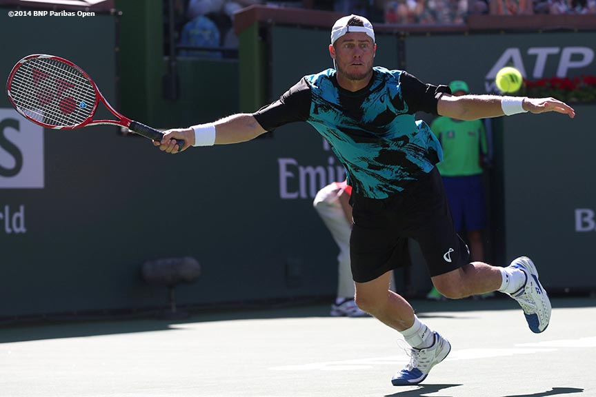 """Lleyton Hewitt lunges for a forehand during a match against Kevin Anderson Saturday, March 8, 2014 in Indian Wells, California."""
