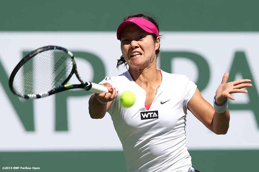 """Li Na hits a forehand during a match against Jie Zheng at the BNP Paribas Open Saturday, March 8, 2014 in Indian Wells, California."""