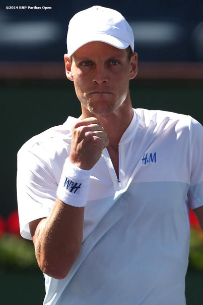"""Tomas Berdych reacts while playing Roberto Bautista Agut in a second round match at the BNP Paribas Open in Indian Wells, California Sunday, March 9, 2014."""