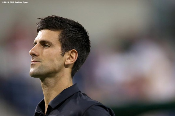 """Novak Djokovic reacts after losing a point to Victor Hanescu in a second round match at the 2014 BNP Paribas Open in Indian Wells, California Sunday, March 9, 2014."""
