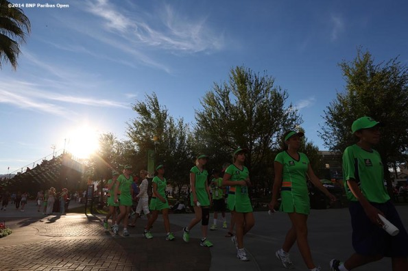 """Ball kids walk through the grounds of the Indian Wells Tennis Garden at the 2014 BNP Paribas Open in Indian Wells, California Sunday, March 9, 2014."""