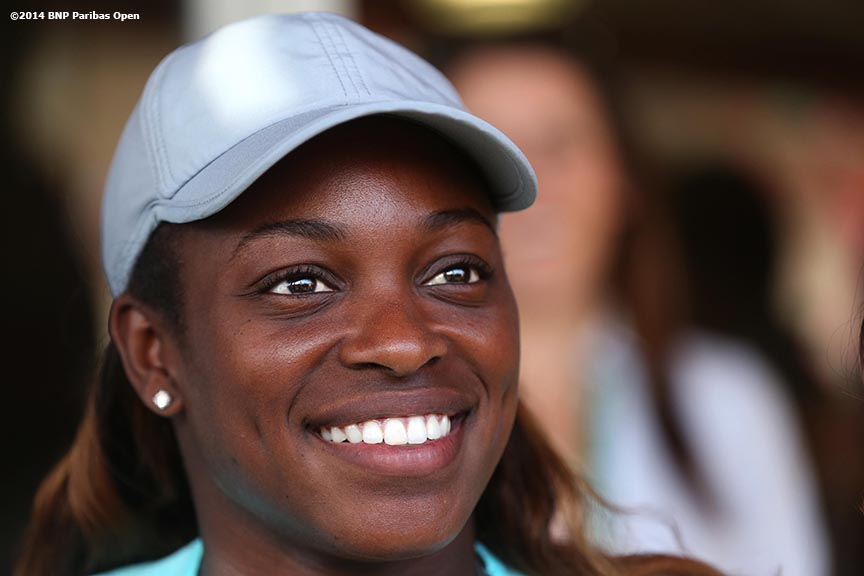 """Sloane Stephens poses for a photograph while signing autographs at the 2014 BNP Paribas Open in Indian Wells, California Sunday, March 9, 2014."""