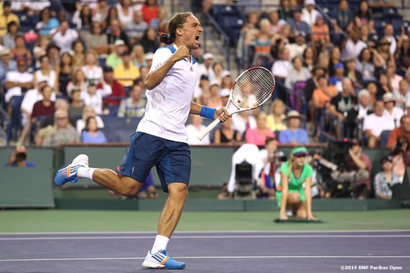 """Alexandr Dolgopolov reacts after defeating Rafael Nadal in three sets at the 2014 BNP Paribas Open Monday, March 10, 2014 in Indian Wells, California."""