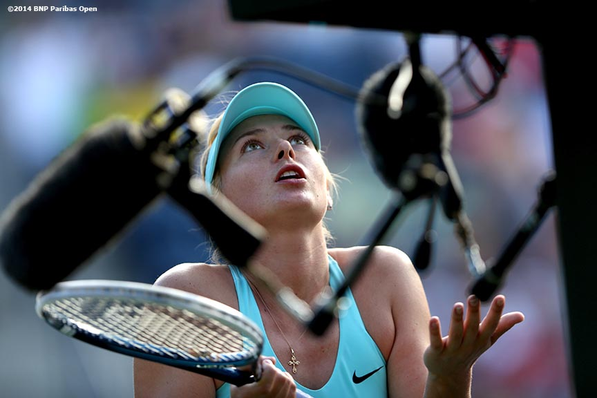 """Maria Sharapova argues with the chair umpire during a third round match against Camila Giorgi at the 2014 BNP Paribas Open Monday, March 10, 2014 in Indian Wells, California."""