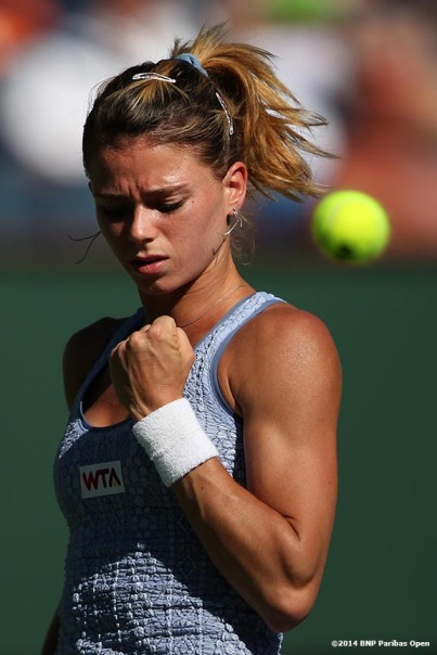 """Camila Giorgi reacts after winning a point against Maria Sharapova in the third round at the BNP Paribas Open Monday, March 10, 2014 in Indian Wells, California."""