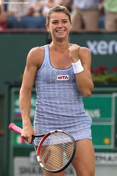 """""""Camila Giorgi reacts after defeating Maria Sharapova in the third round at the BNP Paribas Open Monday, March 10, 2014 in Indian Wells, California."""""""